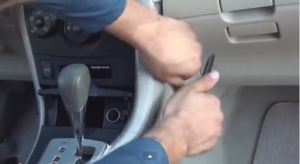 Unclip side panels from lower center console(beside shifter) with a panel removal tool