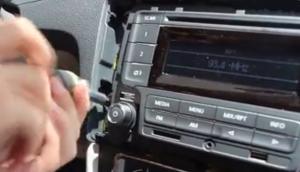 2013-2015 VW Santana radio removal step 2