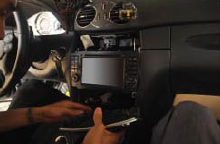 18. Install the air conditioner panel, the car charger, the ashtray, the heated seat and the control panel back.