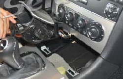 4. Remove the car charger and ashtray assembly.