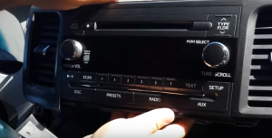 6. Take the factory radio out of the dashboard