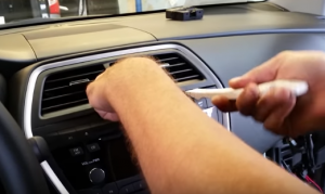 Remove the air vent with a plastic removal tool