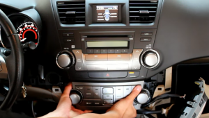 Grip onto the A/C control panel, and give it quick tug to remove