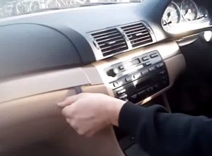 Remove the surrounding trim panel with a plastic removal tool