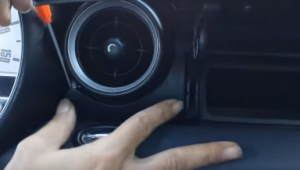 Open the glove box compartment, and remove the panel inside shown as the picture