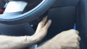 Pop out the panel beneath the steering wheel with a lever and your hands