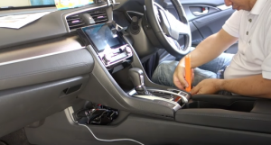 Use a flat head plastic removal tool to pry the trim panels