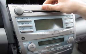 Take out the original car radio gently