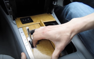 Remove the panel around the shift lever and then unplug the connector at the backside