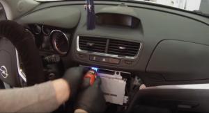 Remove screws that are holding the original car radio