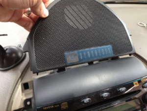 Carefully reinstall top center channel speaker grill panel