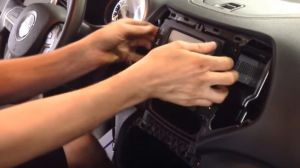 Gently remove the original radio
