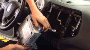 Disconnect the connectors and cables at the back of the radio