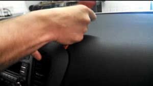 Use the plastic removal tool to remove the decorated panel around the radio