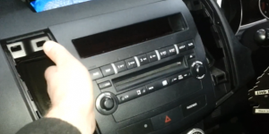 Try to remove the car radio panel