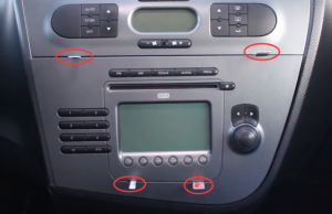 Insert the removal keys to the original car radio so as to release the original car radio