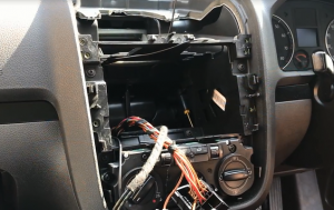 The original car radio is removed successfully