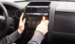 Prepare a flat plastic removal tool and use it to pry the air vent