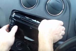 Take the factory radio out of the dashboard