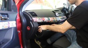 Remove trim pieces to access original car radio as follows