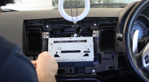 Remove the four screws that are holding the originalcar radio in place