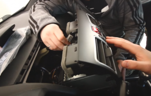 Make the connector plug to the back of the trim panel of the new car radio