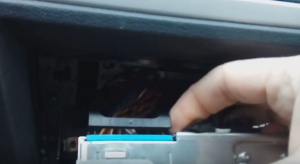 Pull out the original car radio and disconnect the connector and plugs behind the radio